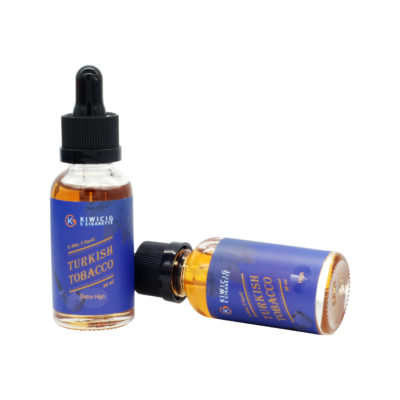 2 bottle of Turkish tobacco vape juice, 1 stand up right and 1 lying down